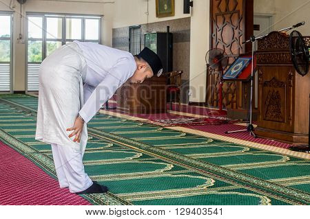 Labuan,Malaysia-March 19,2016:Young muslim performing prayers inside the mosque. The five prayers are Fajr, Zuhr, Asr, Maghrib and Isha.