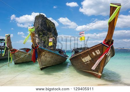 CRABI PROVINCE THAILAND - FEBRUARY 02 2015: Traditional thai long tail boats waiting for tourists to travel to beautiful islands in Thailand