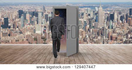 Businessman walking against wooden planks