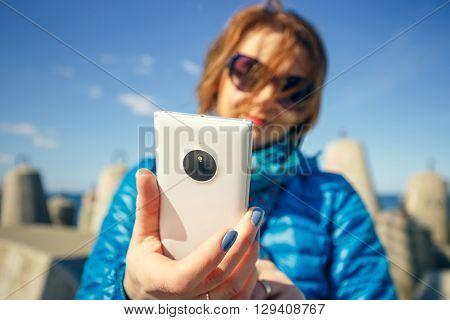 Woman Taking Self-portrait On Smartphone