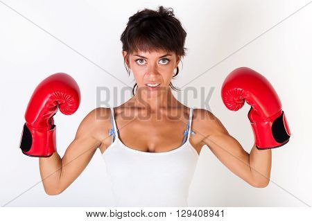 Young Beautiful Woman Guarding While Wearing Boxing Gloves On White Isolated Background - Fitness An