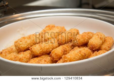 A Fish fingers on the white plate