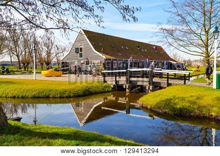 Zaanse schans, Netherlands - April 1, 2016: Wooden shoes, clogs or klompens museum, Zaanse Schans village, Holland, people around