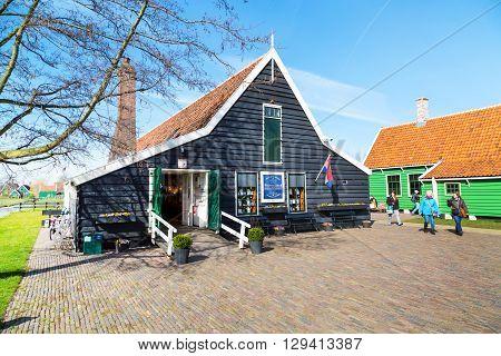 Zaanse schans, Netherlands - April 1, 2016: Delft Blue pottery shop in Zaanse Schans, North Holland, traditional village, tourists