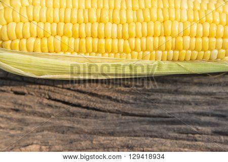 the sweet corn with old wooden background