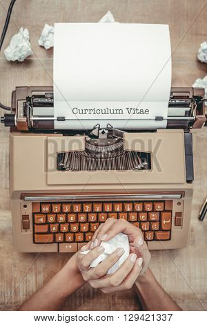 The word curriculum vitae against above view of old typewriter