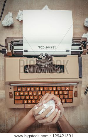 The word top secret against above view of old typewriter
