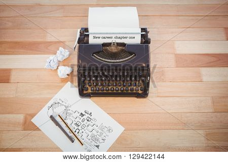 The word new career. chapter one and brainstorm graphic against typewriter and paper on table in office