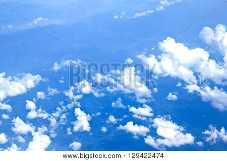 Blue sky and Clouds looking from the Airplane