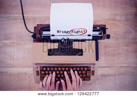 Words wrong-right against white background against above view of old typewriter