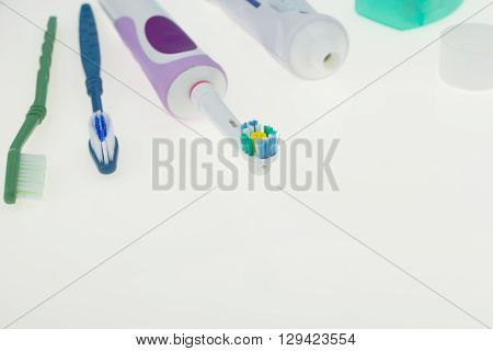 Electric And Classic Toothbrushes With Toothpaste, On White With Copy-space