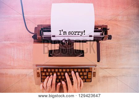 The sentence I am sorry against white background against above view of old typewriter