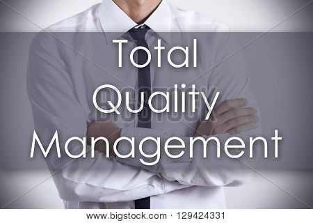 Total Quality Management - Young Businessman With Text - Business Concept