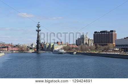 MOSCOW, RUSSIA - APRIL 12, 2016: Panoramic view of Moscow from the Krymsky Bridge view on Krymskaya waterfront the left is a monument to Peter I right - President Hotel