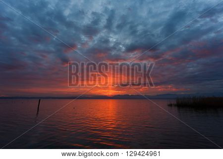 Sunset over the Garda lake from point of Sirmione town in Italy