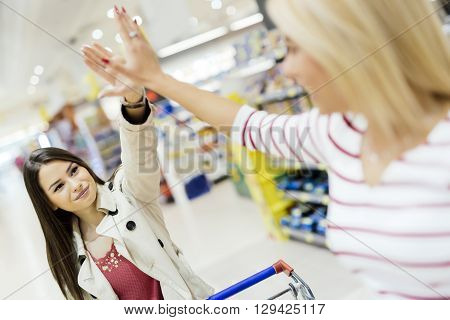 Women satisfied after shopping in a supermarket