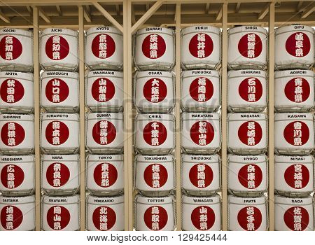 MILAN, ITALY - JUNE 29 2015: Sake Barrels display at Japanese Pavilion at Expo 2015 in Milan with name of the main cities of the country