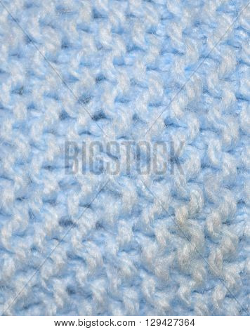close up knitted texture fabric background in blue wool