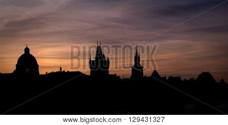Morning silhouette of Old town churches in Prague Czech republic