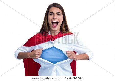 Portrait of a woman pretending to be superhero on white background