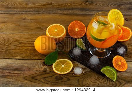 Fresh citrus cocktail on wooden table. Fruit cocktail. Fruit drink. Citrus lemonade. Fruit lemonade. Summer drink