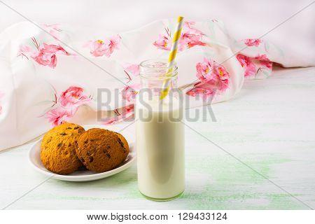 Homemade cookies and Milk bottle with straw. Breakfast cookies. Sweet pastry. Sweet dessert. Homemade cookies