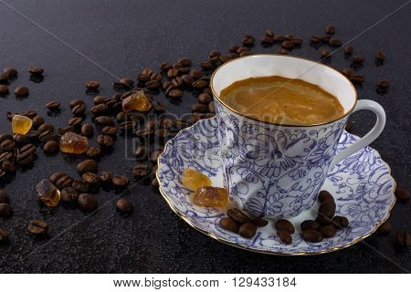Porclean cup of coffee and brown sugar. Cup of coffee. Morning coffee. Coffee break. Strong coffee