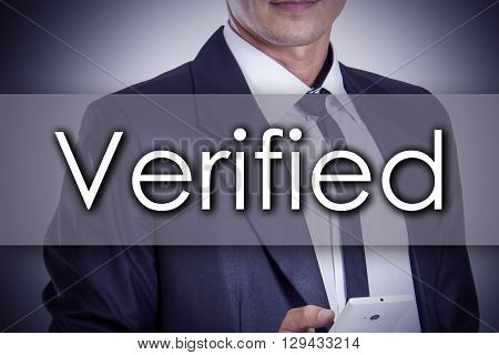 Verified - Young Businessman With Text - Business Concept