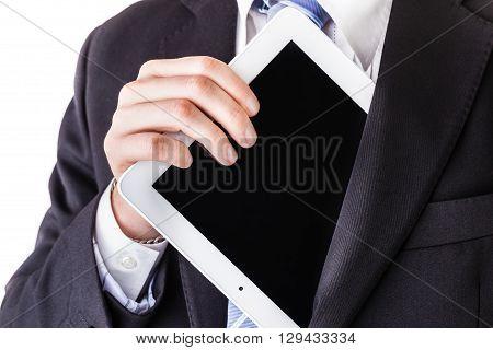 Businessman Pulling Tablet From Pocket