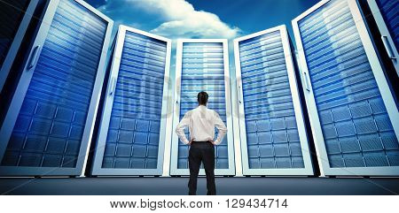 Rear view of classy young businessman posing against composite image of server room