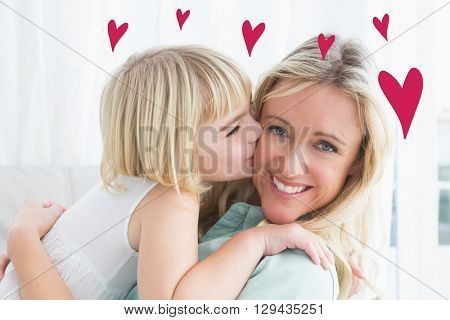 Red Hearts against mother sitting on the couch with her daughter kissing her cheek