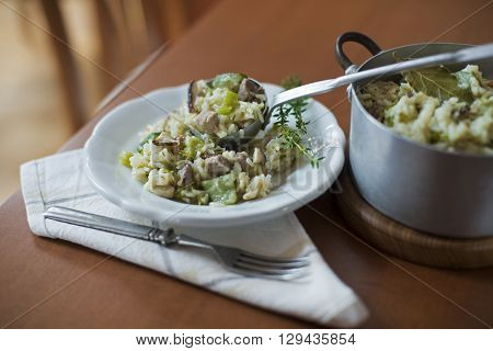 Risotto with mushrooms meat and fresh herbs.