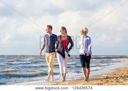 Friends enjoying sunset at German north sea beach