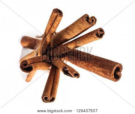 Abstract view of cinnamon sticks on white background