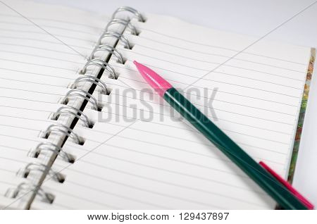 Empty page in spiral bound notebook with pencil