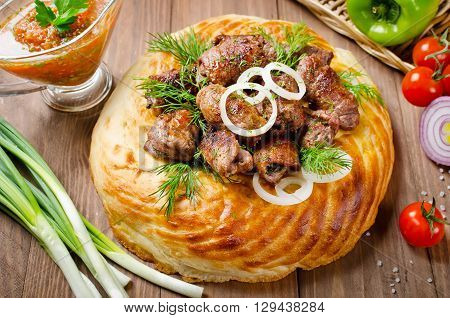 Lamb rolls with cilantro and purple onion on the tortilla. Fragrant and delicious barbecue