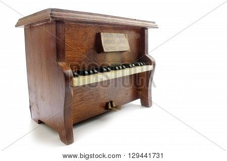 Wooden upright piano isolated on white background.