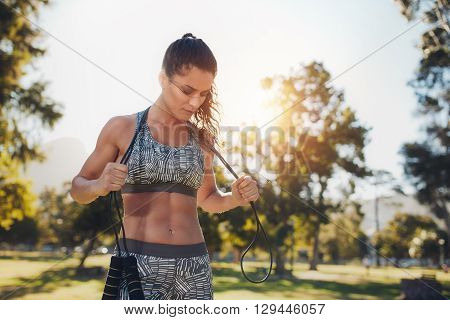 Fit Young Woman With A Skipping Rope At The Park