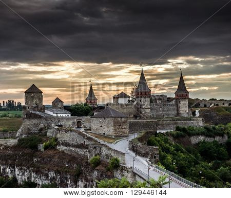 view on Kamenetz-Podolsky fortress at sunset,  Ukraine