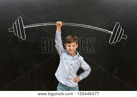 cute little boy easily rising drawn on the blackboard barbell on finger