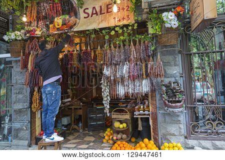TBILISI GEORGIA - MAY 07: Churchkhela at the street market in Tbilisi Georgia on May 07 2016