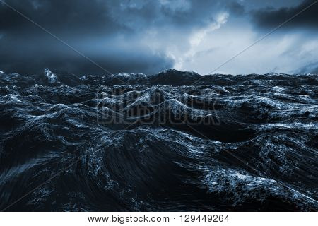 Rough blue ocean against blue and orange sky with clouds