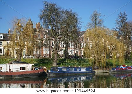 CAMBRIDGE, UK - FEBRUARY 24: House boats moor up below weeping willows along the banks of the River Cam in Cambridge, England on February 24, 2016.