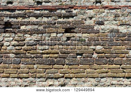 Ancient Roman brickwork in old wall Pevensey Castle East Sussex
