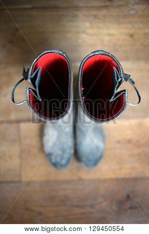 POV of wellington boots on wooden floor