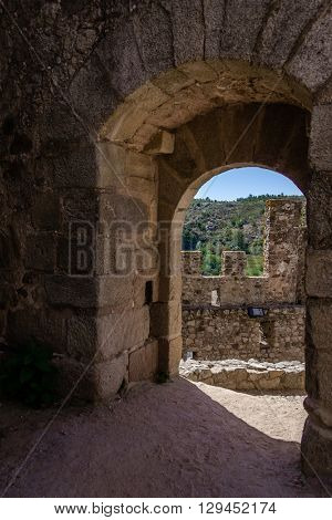 Almourol, Portugal - July 18, 2015: Bailey entrance of the Templar Castle of Almourol. One of the most famous castles in Portugal. Built on a rocky island in the middle of Tagus river.