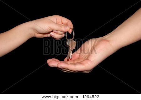 Handing Over The Keys, Isolated On Black With Clipping-Path Incl