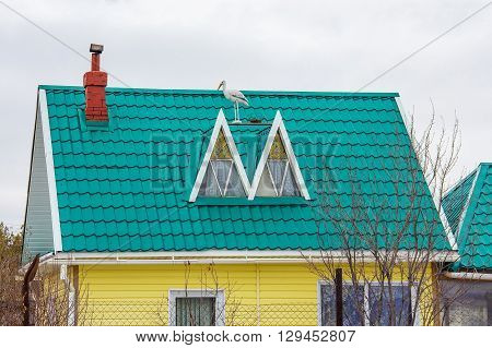 Russia Siberia Novosibirsk region Berdsk - April 17 2016: the country house with the roof covered with metal tile