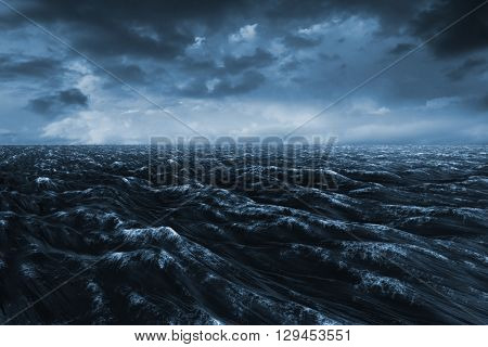 Dark blue ocean against blue and orange sky with clouds