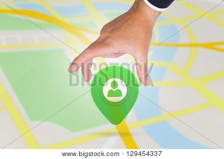 Businessman pointing with his finger against green application symbol